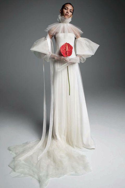 Gown, Dress, Clothing, Fashion model, Wedding dress, Shoulder, Bridal accessory, Fashion, Bridal clothing, Fashion design,