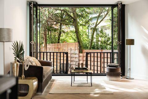 Room, Property, Interior design, Furniture, Living room, Home, House, Building, Window, Real estate,