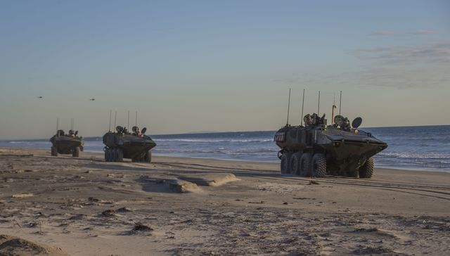 us marines with amphibious vehicle test branch, marine corps tactical systems support activity, drive new amphibious combat vehicles along the beach during low light surf transit testing at avtb beach on marine corps base camp pendleton, california, dec 18, 2019 the test was designed to assess and verify how well marines can interface with the vehicle and operate at night the acv is an eight wheeled armored personnel carrier designed to fully replace the corps' aging fleet of amphibious assault vehicles  us marine corps photo by lance cpl andrew cortez