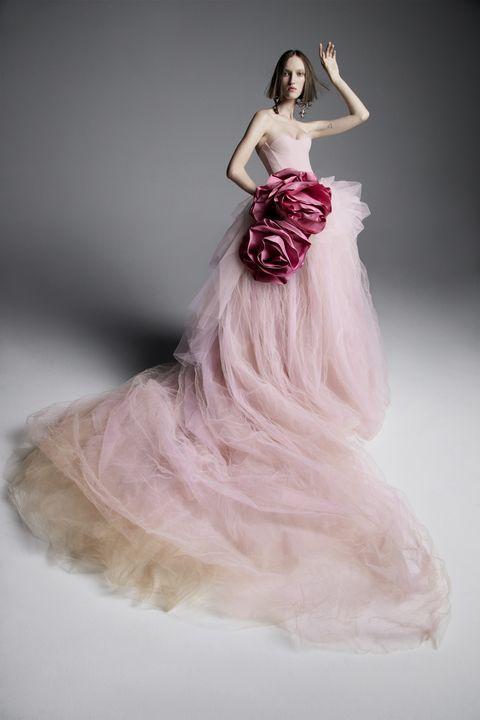 Gown, Dress, Clothing, Wedding dress, Fashion model, Pink, Shoulder, Bridal party dress, Bridal clothing, Formal wear,