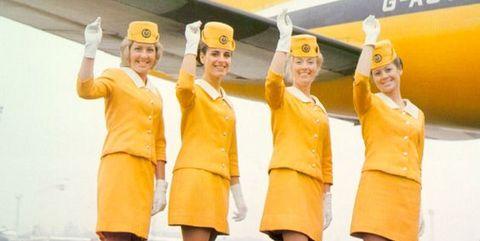 Yellow, Flight attendant, Vehicle, Team, Airline, Air travel, Crew, Smile, Uniform, Travel,