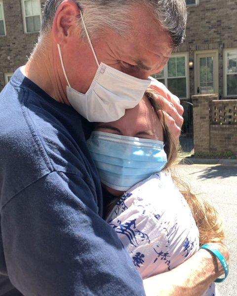 eliza paris and her father hug in medical face masks