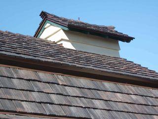 hanging christmas lights on tile roof