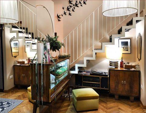 Interior design, Room, Furniture, Living room, Building, Property, Floor, Ceiling, Wood flooring, Cabinetry,