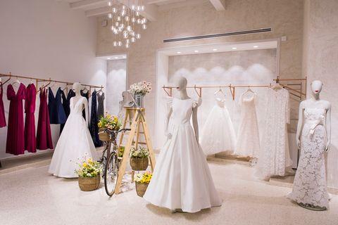 Dress, Photograph, Clothing, Gown, Wedding dress, Bridal clothing, Bridal party dress, Bride, Yellow, Room,
