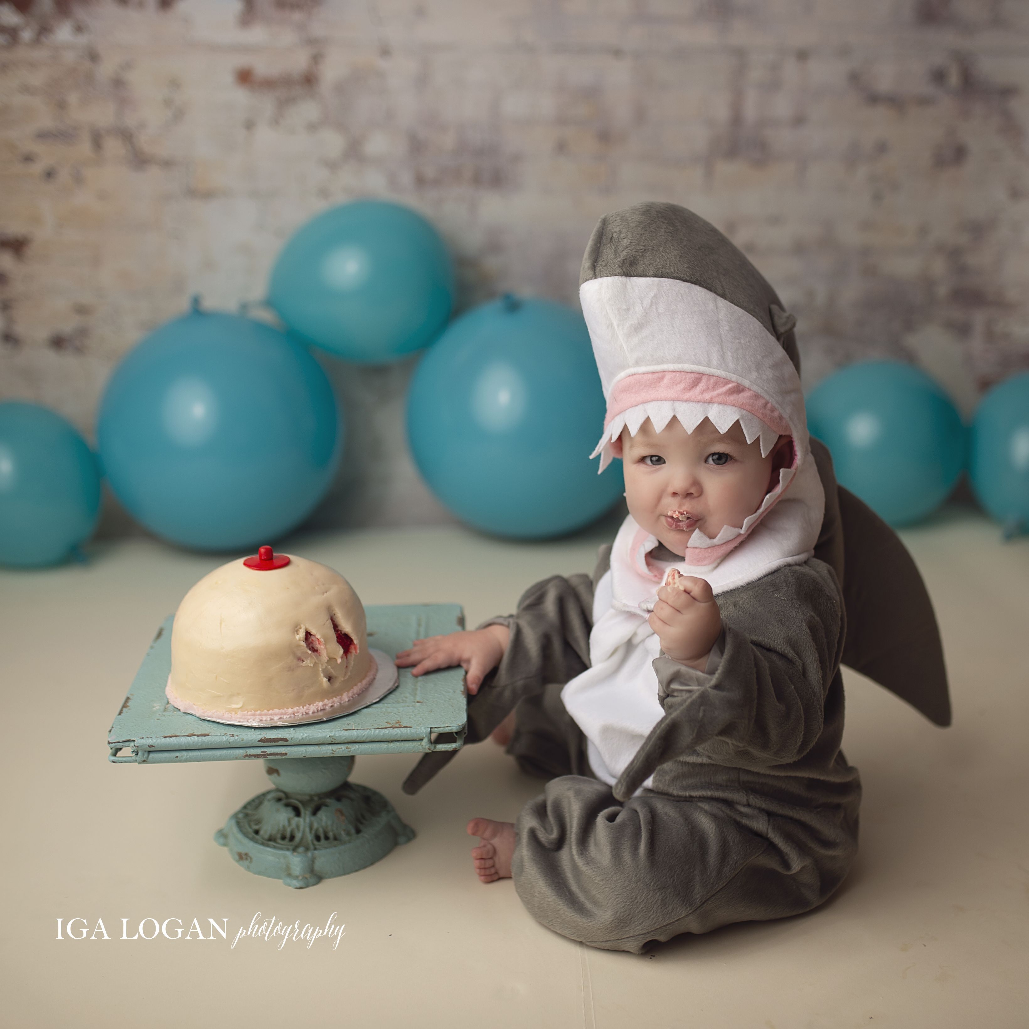 This Photo Shoot of a 'Baby Shark' Eating a Boob Cake Is an Homage to Moms Who Breastfeed Biters
