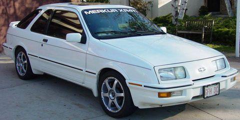 Land vehicle, Vehicle, Car, Coupé, Tree, Hubcap, Sedan, Automotive wheel system, Tire care, Hood,