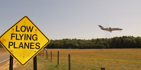 Airplane, Aircraft, Pasture, Plain, Land lot, Sign, Flight, Grassland, Field, Aerospace engineering,