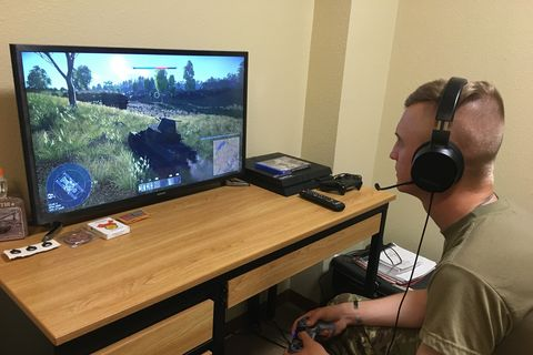 sgt david ose, a section leader in d troop, 6th squadron, 9th cavalry regiment, 3rd brigade combat team,1st cavalry division plays an online game that the unit is using to help maintain readiness while protecting the force the troop uses it to train on tactics, maneuver and communications army photo by capt mike manougian