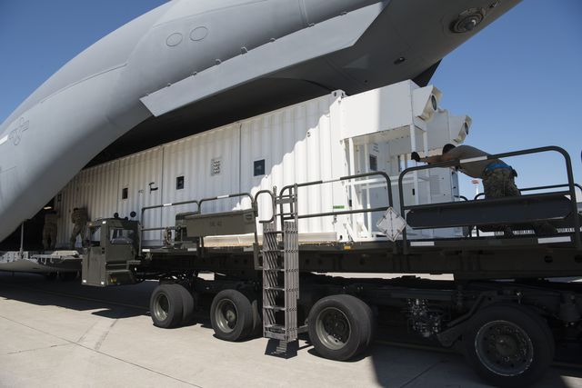 us air force personnel assigned to the 721st aerial port squadron push a negatively pressured conex onto a c 17 globemaster iii aircraft at ramstein air base, germany, june 24, 2020 the npc was developed for high capacity, immediate transport of covid 19 infected personnel the npc is an infectious disease containment unit designed to minimize contamination risk to aircrew and medical attendants, while allowing in flight medical care for patients afflicted by diseases like covid 19  us air force photo by senior airman milton hamilton