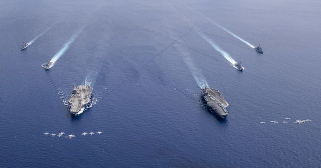 200706 n vw723 1114 south china sea july 6, 2020 aircraft from carrier air wing 5 and carrier air wing 17 fly in formation over the nimitz carrier strike force csf the uss nimitz cvn 68 and uss ronald reagan cvn 76 carrier strike groups are conducting dual carrier operations in the indo pacific as the nimitz csf us navy photo by mass communication specialist 3rd class keenan danielsreleased
