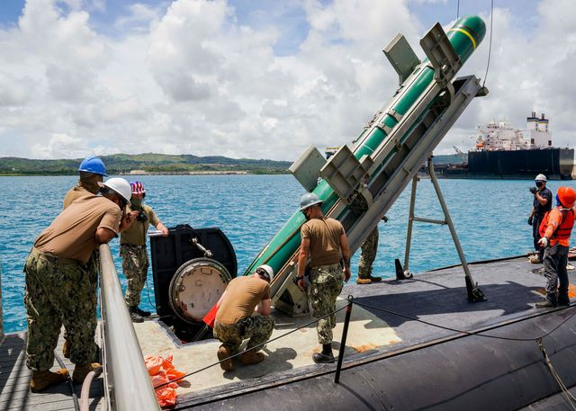 santa rita, guam aug 12, 2020 sailors assigned to the los angeles class fast attack submarine uss asheville ssn 758 lower an encapsulated harpoon loading shape into the boat during harpoon shipping, loading and handling certification training the certification is required in order for the submarine to carry and employ warshot tactical harpoons the harpoon system provides commanders with lethal all weather anti ship capability to rapidly engage targets at long ranges us navy photo by mass communication specialist 2nd class kelsey j hockenberger