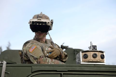 soldier dons the integrated visual augmentation system capability set 3 hardware while mounted on a stryker in joint base lewis mccord, wa