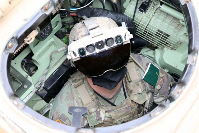 soldier dons the integrated visual augmentation system capability set 3 hardware while mounted on a bradley in joint base lewis mccord, wa
