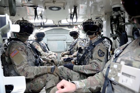 soldiers don the integrated visual augmentation system capability set 3 hardware while mounted in a stryker in joint base lewis mccord, wa