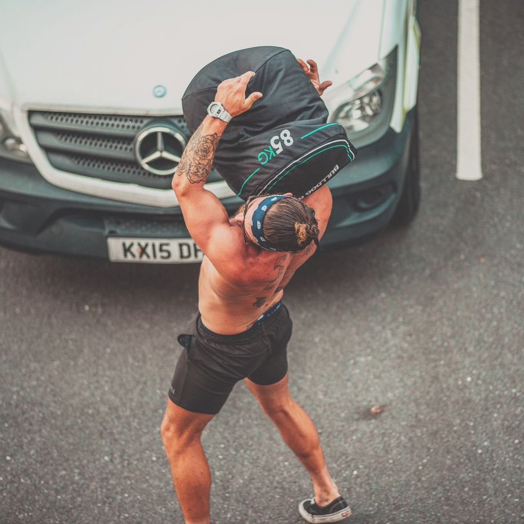 Tackle This 360-Rep Strongman Leg Day Challenge to Build Muscle and KO Fat