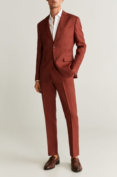 Suit, Clothing, Formal wear, Tuxedo, Outerwear, Standing, Blazer, Suit trousers, Brown, Pantsuit,