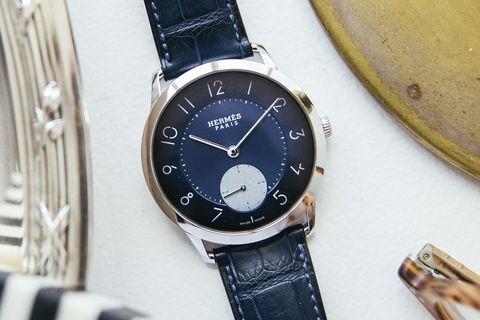 Watch, Analog watch, Watch accessory, Fashion accessory, Strap, Jewellery, Material property, Brand, Metal, Hardware accessory,