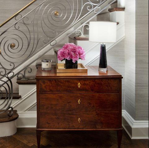Furniture, Dresser, Table, Room, Interior design, Chest of drawers, Drawer, Iron, Material property, Stairs,