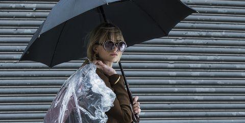 Clothing, Umbrella, Textile, Street fashion, Gown, Costume design, Costume, Fashion design, Rain, Acting,