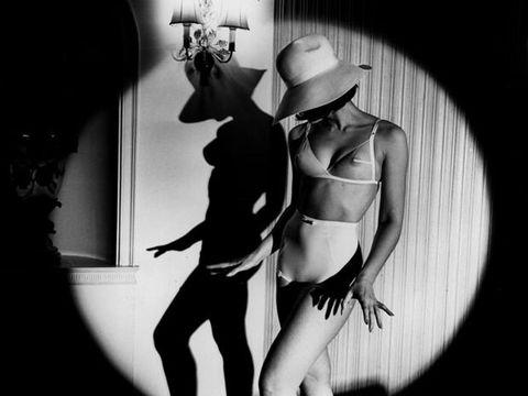 Hat, Monochrome, Waist, Sun hat, Thigh, Monochrome photography, Costume accessory, Abdomen, Black-and-white, Undergarment,