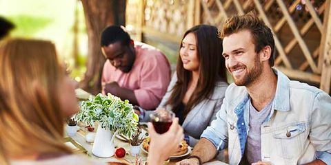 man eating at outdoor table
