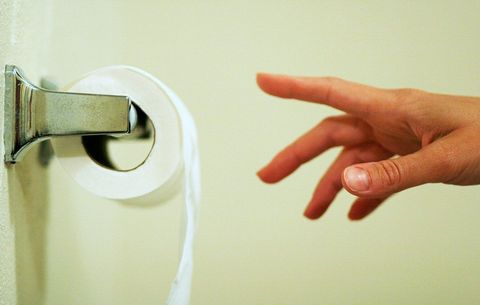 Reaching for toilet paper