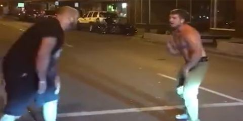 man punches MMA fighter