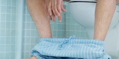 protein constipation-man on toilet