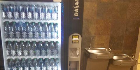 Vending Machine Next To Water Fountain