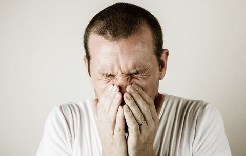 muffle a sneeze