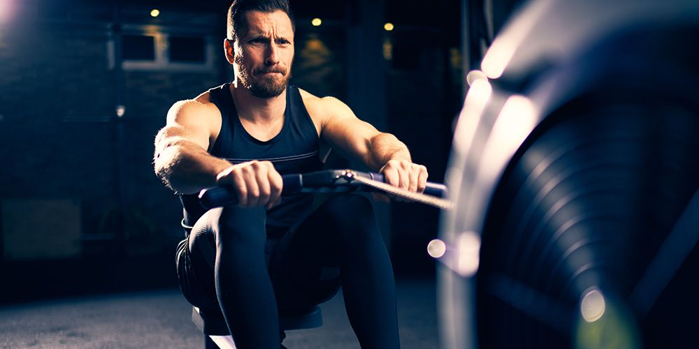 ​4 Rowing Workouts That Burn Fat and Build Muscle
