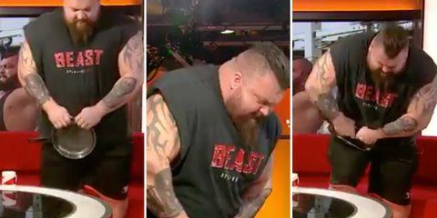 strongest man bends frying pan