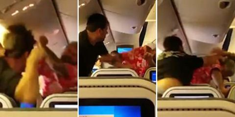 two men fight on plane