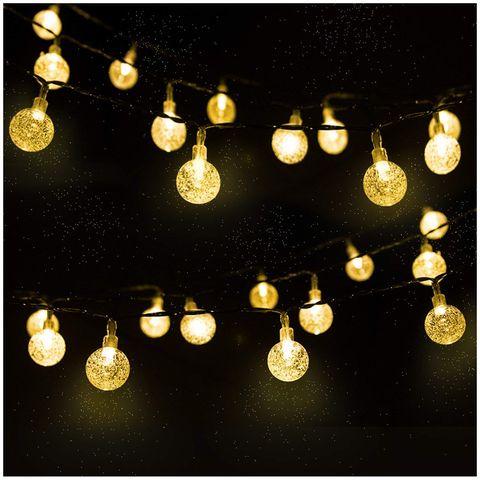 Lighting, Light, Yellow, Light fixture, Lighting accessory, Lantern, Circle, Christmas lights, Christmas decoration, Pattern,