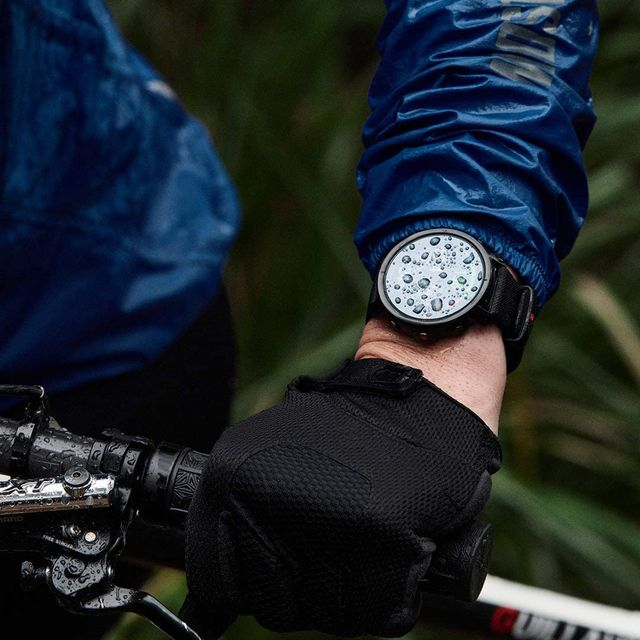 Blue, Wrist, Elbow, Bicycle handlebar, Watch, Black, Electric blue, Cobalt blue, Bicycle, Strap,