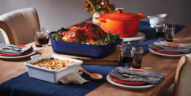 le creuset cookware on table