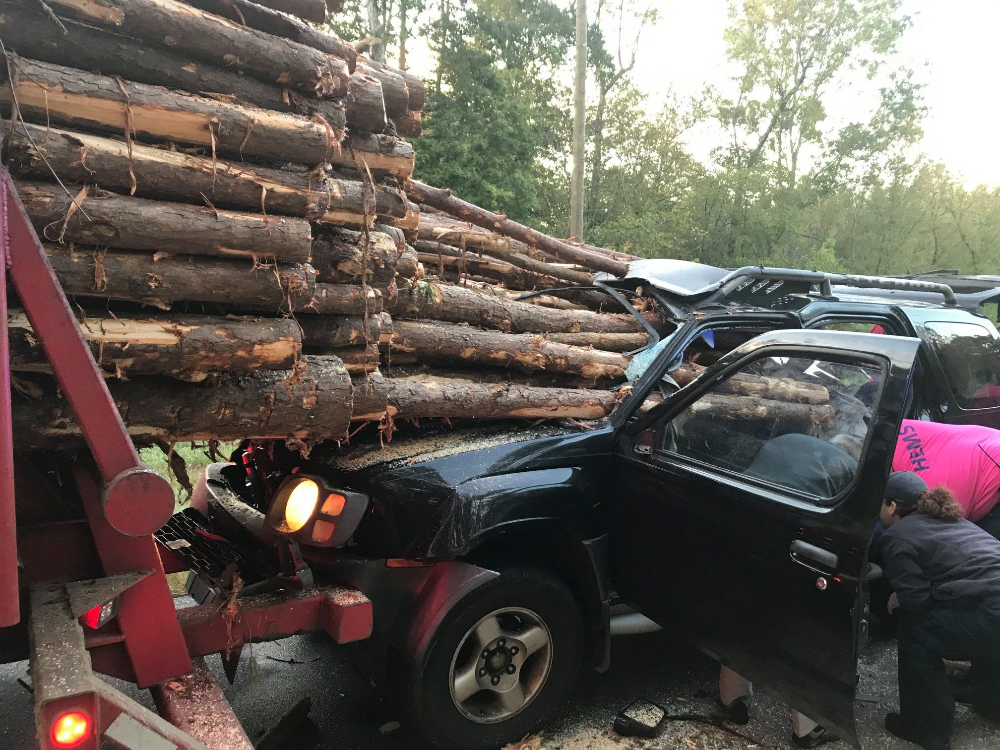 Dozens of Logs Smash Through Windshield, Driver Miraculously Survives