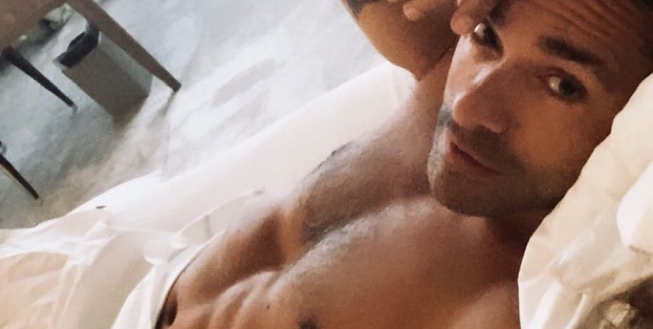 Kelly Ripa Just Shared a Shirtless Photo of Mark Consuelos in Bed