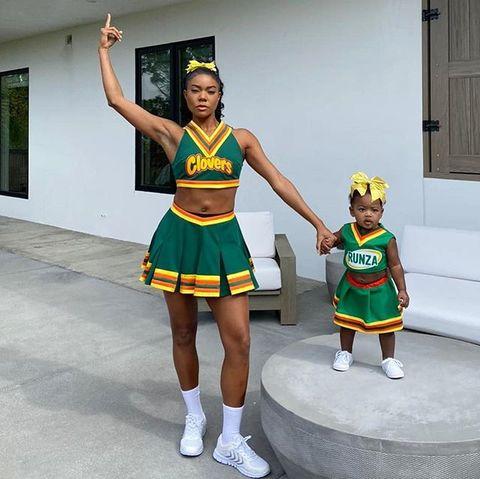 Cheerleading uniform, Sports uniform, Uniform, Cheerleading, Majorette (dancer), Dancer, Costume,