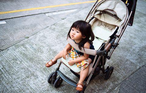 girl in stroller