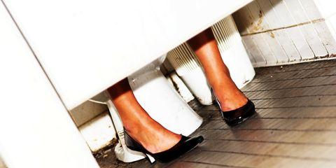 woman in public restroom stall