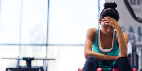 Woman bored with her workout