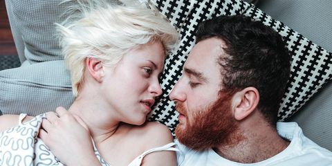 couple in bed worrying about zika virus