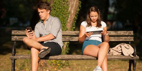 a couple looking at technology