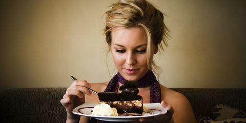 woman eating cake full of sugar