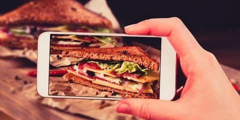 woman instagramming food photo
