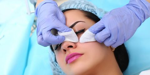 woman having pimple extracted