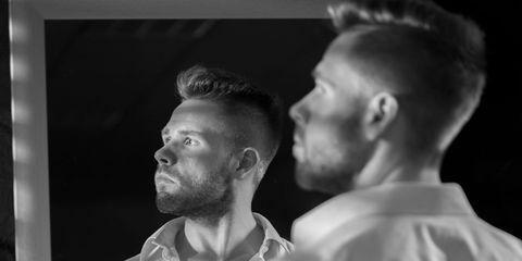 Man looking in mirror.