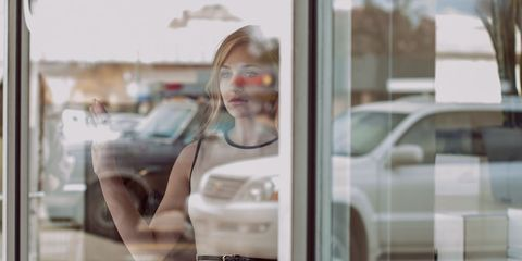A woman looking out the window.
